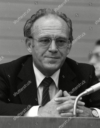 Dr. Heinz Eyrich folds his hands in the state ministry for inner affairs, after Eyrich, state minister for justice, was elected as new minister for inner affairs, at Baden-Wuerttemberg's state parliament in Stuttgart, West Germany, taking over the position from Roman Herzog