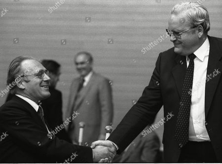 Roman Herzog, right, congratulates Dr. Heinz Eyrich in the state ministry for inner affairs, after Eyrich, state minister for justice, was elected as new minister for inner affairs, at Baden-Wuerttemberg's state parliament in Stuttgart, West Germany, taking over the position from Herzog