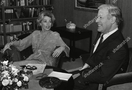 German actress and writer Lilli Palmer (Lilli Maria Peiser), left, is pictured during her meeting with West German Chancellor Helmut Schmidt in Bonn, West Germany, as she makes a TV interview with Schmidt