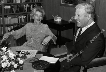 Stock Image of German actress and writer Lilli Palmer (Lilli Maria Peiser), left, shares a joke with West German Chancellor Helmut Schmidt in Bonn, West Germany, as she does a recorded TV interview with Schmidt