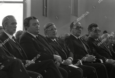 Stock Photo of West German President Carl Karstens, Hesse's State governor, Holger Boerner, Chancellor Helmut Schmidt, Foreign Minister Hans Dietrich Genscher and Ekkehard Gries (Free Democrats - FDP -delegate), sit in the front row of the Paulskirche (Paul's Church) in Frankfurt am Main, West Germany at the funeral procession for assassinated Heinz Herbert Karry, Minister of Finance for the West German State Hesse