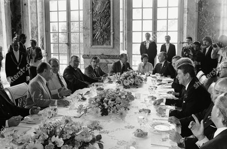 Ronald Reagan, Francois Mitterrand, Pierre Elliott Trudeau, Margaret Thatcher President Ronald Reagan sits opposite host President Francois Mitterrand of France and other guests at a luncheon on the final day of the western economic summit, at Versailles Palace, France. Clockwise, from left: President Mitterrand, Canadian Prime Minister Pierre Elliott Trudeau, French Premier Pierre Mauroy, Canadian external affairs secretary Mark McGuigan, British foreign secretary Francis Pym, an unidentified interpreter, Italian foreign minister Emilio Colombo, Belgian Premier Wilfried Martens, British Prime Minister Margaret Thatcher and President Reagan