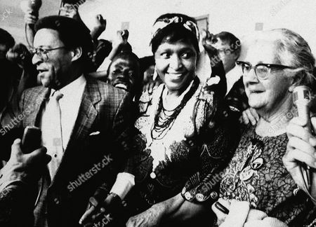 """Black activist Winnie Mandela flanked by Rev Alan Boesak (left) and . Helen Joseph, long-time campaigner for black civil right, (right), at a press conference on in Kagiso, South Africa, to launch a campaign to protect Mrs. Mandela and to stop what organizers said was harassment of """"Our Mother"""