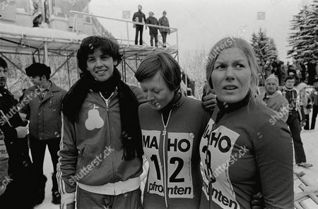 Stock Image of Cindy Nelson Cindy Nelson of the U.S., right, watches competitors on the run during World cup downhill race in Pfronten, West Germany, . Others are unidentified
