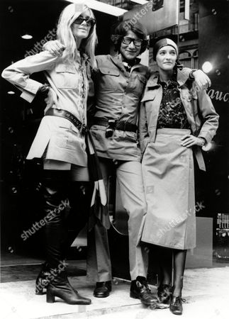 Laurent Parisian fashion designer Yves Saint Laurent, center, poses with Betty Catroux, left, and Loulou de la Falaise outside his Rive Gauche boutique in London, England, on . Saint Laurent and his two friends are wearing his new safari style designs made of khaki cotton