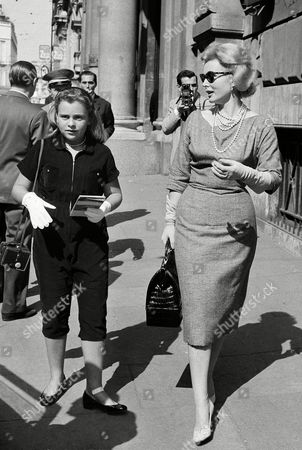 """Gabor Hilton Zsa Zsa Gabor, right, walks with her 11-year-old daughter Francesca Hilton outside Rome's fashionable Grand Hotel, . Gabor is in Rome to play the lead opposite Mario Lanza in a new film """"Silent Melody"""