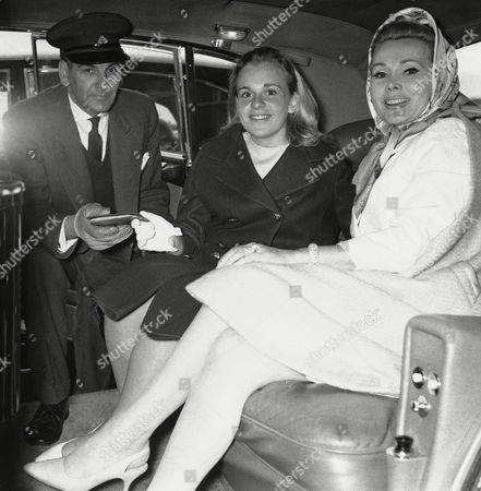 Film actress Zsa Zsa Gabor seen at London Airport on when she met her 16 year old daughter Francesca Hilton. Gabor drove to airport in the Rolls Royce which she has purchased from Angus Ogilvy. When Gabor goes back to USA she is taking car and chauffeur Stan Addersman with her
