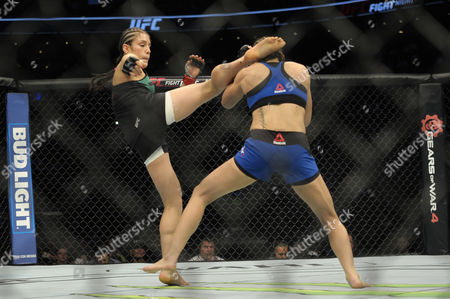 Alexa Grasso of Mexico (L) and Heather Jo Clark of the United States (R) fight in their women's strawweight bout during the UFC Fight Night event