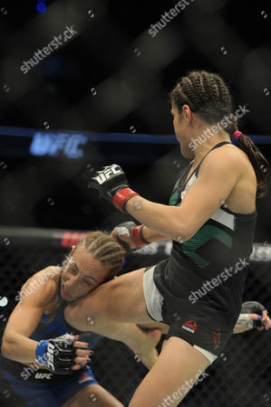 Alexa Grasso of Mexico (R) and Heather Jo Clark of the United States (L) fight in their women's strawweight bout during the UFC Fight Night event