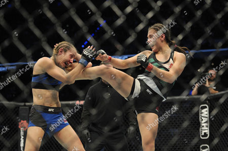 Stock Image of Alexa Grasso of Mexico (R) and Heather Jo Clark of the United States (L) fight in their women's strawweight bout during the UFC Fight Night event