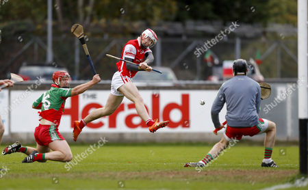 Cuala vs Borris-Kilcotton. Cuala's Con O'Callaghan scores a goal despite the tackle of Jim Fitzpatrick of Borris-Kilcotton