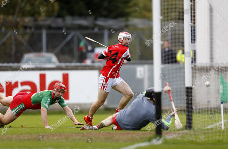 Stock Image of Cuala vs Borris-Kilcotton. Cuala's Con O'Callaghan scores a goal despite the tackle of Jim Fitzpatrick of Borris-Kilcotton