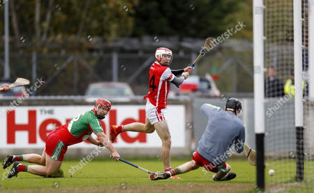 Stock Picture of Cuala vs Borris-Kilcotton. Cuala's Con O'Callaghan scores a goal despite the tackle of Jim Fitzpatrick of Borris-Kilcotton