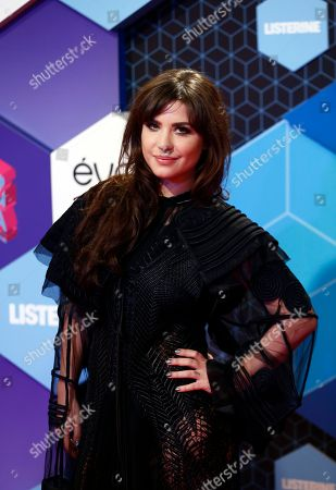 Betty Autier poses for photographers upon arrival at the MTV European Music Awards 2016 in Rotterdam, Netherlands