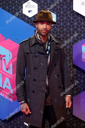 Mr Probz poses for photographers upon arrival at the MTV European Music Awards 2016 in Rotterdam, Netherlands