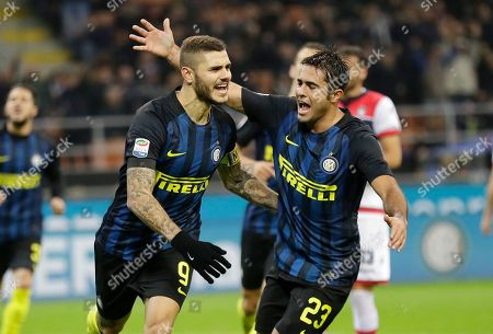 Inter Milan's Mauro Icardi, left, celebrates with his teammate Citadin Martins Eder after scoring during the Serie A soccer match between Inter Milan and Crotone at the San Siro stadium in Milan, Italy