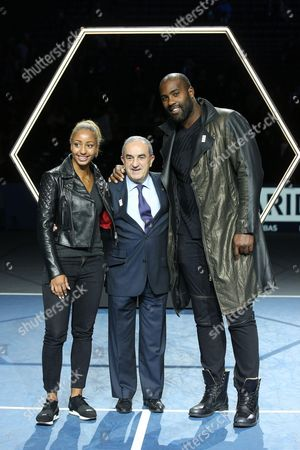 Estelle Mossely Olympic champion of boxing, Jean Gachassin president of FFT and Teddy Riner Olympic Champion of Judo pose after the Mens Singles Final against John Isner of the United States on day seven of the BNP Paribas Masters at Palais Omnisports de Bercy