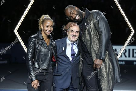 Stock Picture of Estelle Mossely Olympic champion of boxing, Jean Gachassin president of FFT and Teddy Riner Olympic Champion of Judo pose after the Mens Singles Final against John Isner of the United States on day seven of the BNP Paribas Masters at Palais Omnisports de Bercy