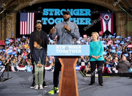Hillary Clinton, Lebron James, J.R. Smith, Demi Smith LeBron James, center, accompanied by Cleveland Cavaliers basketball player J. R. Smith, left, his daughter Demi, bottom left, and Democratic presidential candidate Hillary Clinton, right, speaks at a rally at the Cleveland Public Auditorium in Cleveland