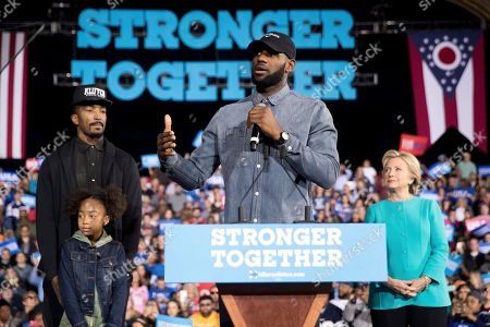 Stock Photo of Hillary Clinton, Lebron James, J.R. Smith, Demi Smith LeBron James, center, accompanied by Cleveland Cavaliers basketball player J. R. Smith, left, his daughter Demi, bottom left, and Democratic presidential candidate Hillary Clinton, right, speaks at a rally at the Cleveland Public Auditorium in Cleveland