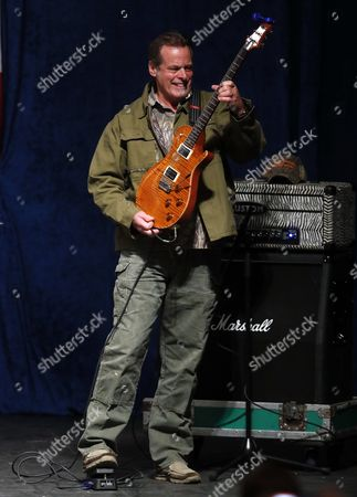 Ted Nugent Musician Ted Nugent plays guitar at a campaign rally for Republican presidential candidate Donald Trump in Sterling Heights, Mich