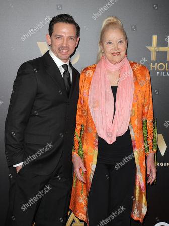 Sally Kirkland and guest