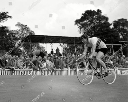 Italian cyclist, Mario Ghella, left, beats World Sprint Champion, Britain's Reg Harris, in the men's 1,000-metres Olympic Games Cycle Race at Herne Hill Race Track, London