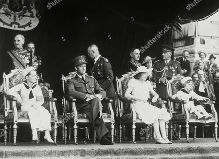 Belgium celebrated its national fete on July 21, exactly a week after the Bastille Day celebrations of the French republic. The ceremonies in Brussels included a procession of troops and tradesmen's guilds before King Leopold. From left to right: Prince Baudoin, King Leopold, Princess Josephine Charlotte and the little Prince of Liege in the royal stand as they watched the big parade during the national day celebrations in Brussels, Belgium, on