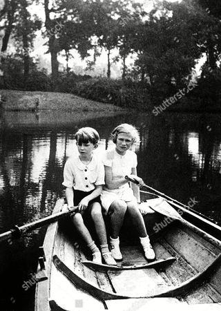 Crown Prince Baudouin and his sister, Princess Josephine Charlotte, the children of King Leopold of the Belgians, taking a row on the lake at the Royal Park at Lauren, Belgium, on