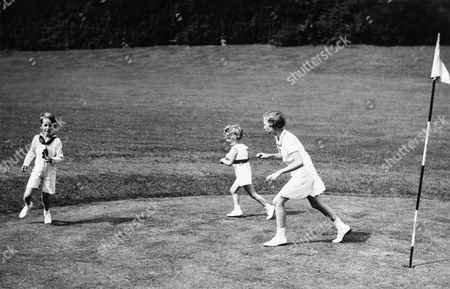 The royal children of King Leopold of the Belgians, at play in the grounds of the Royal Chateau of Laeken, Belgium, on . Prince Baudouin is seen on left, Prince Albert, centre, and Princess Josephine Charlotte