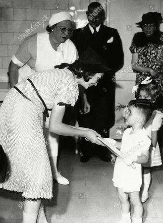 Princess Josephine Charlotte, the daughter of King Leopold of the Belgians, visited the crèche which bears her name in one of the most populous districts of Brussels on . Two very small occupants of the crèche present a gift to Princess Josephine Charlotte