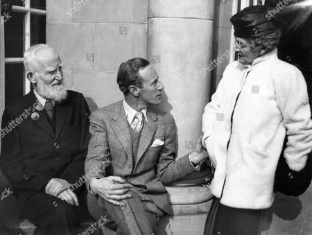 "George Bernard Shaw, Leslie Howard, Lady Asquith Great preparations have been made for the filming of Bernard Shaw's famous play ""Pygmalion"" and it has been planned on a big scale to be pinewood studios' prestige picture at their studios. The film will be 12 weeks in the making and will cost about £160,000. It is to be made by Pascal Production, with Gabriel Pascal as producer, while Leslie Howard and Anthony Asquith are joint directors. Leslie Howard also stars with Wendy Hiller. To inaugurate the film a luncheon was held at which many celebrities attended, including Bernard Shaw ""To inspire the principals with courage and confidence."" Bernard Shaw, left, Leslie Howard, center and Lady Asquith at the film luncheon at Pinewood Club, Iver Heath, Buckinghamshire, England on"