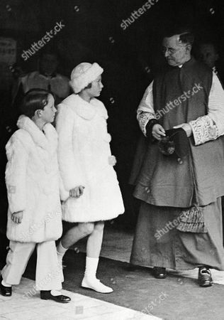 Prince Baudouin and Princess Josephine Charlotte, dressed in white, arriving at the Church of St. Michel and Gudule, Brussels, on