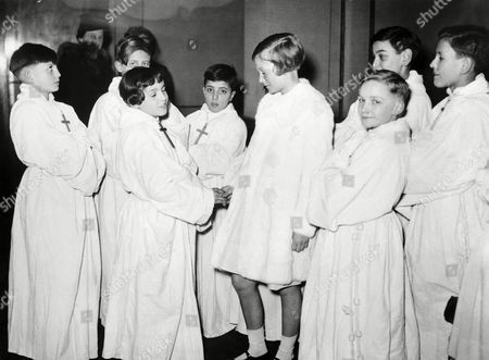 Princess Josephine Charlotte, daughter of King Leopold of the Belgians, was present, with the little Singers of the Wooden Cross. Princess Josephine Charlotte, centre, shaking hands with one of the little singers, in Brussels, on