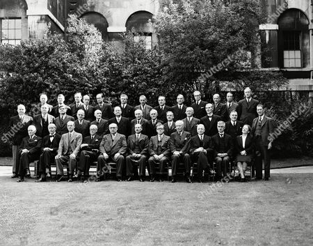 Prime Minister Clement Attlee and members of his Socialist cabinet posed in the garden of No. 10 Downing Street, London on the morning of . Back row from left; Chief Whip Sir Edward Bridges, Sir Frank Soskice, John Burns Hynd, Earl of Listowel, E.J Williams, Lewid Silkin, James Griffiths, Lord Winster, Philip Noel-Baker, Rt Hon. Wilfred Paling, Sir Hartley Shawcross and Norman Brook. Middle row from left; Rt. Hon. Sir Ben Smith, Rt. Hon. John Wilmot, Rt. Hon. Aneurin Bevan, Rt. Hon. George Alfred Isaacs, Rt. Hon Viscount Stansgate, Rt. Hon. G.N Hall, Rt. Hon. Lord Pethick Lawrence, Rt. Hon. John James Lawson, Rt. Hon. Joseph Westwood, Rt. Hon. Emmanual Shinwell, Rt. Hon. T Williams, Rt. Hon. Sir Alfred Barnes, Rt. Hon. G Tomlinson. Front row from left; Rt. Hon. Viscount Addison, Lord Jowitt, Rt. Hon. Sir Stafford Cripps, Rt. Hon. Arthur Greenwood, Rt. Hon. Ernest Bevin, Rt. Hon. Clement Attlee, Rt. Hon. Herbert Morrison, Rt. Hon. Hugh Dalton, Rt. Hon. Albert Victor Alexander, Rt. Hon. James Chuter Ede, Rt. Hon. Ellen Wilkinson