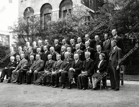 Prime Minister Clement Attlee and members of his Socialist cabinet posed in the garden of No. 10 Downing Street, London on the morning of . Back row from left; Sir Edward Bridges, Sir Frank Soskice, John Burns Hynd, Earl of Listowel, E.J Williams, Lewid Silkin, James Griffiths, Lord Winster, Philip Noel-Baker, Rt Hon. Wilfred Paling, Sir Hartley Shawcross and Norman Brook. Middle row from left; Rt. Hon. Sir Ben Smith, Rt. Hon. John Wilmot, Rt. Hon. Aneurin Bevan, Rt. Hon. George Alfred Isaacs, Rt. Hon Viscount Stansgate, Rt. Hon. G.N Hall, Rt. Hon. Lord Pethick Lawrence, Rt. Hon. John James Lawson, Rt. Hon. Joseph Westwood, Rt. Hon. Emmanual Shinwell, Rt. Hon. T Williams, Rt. Hon. Sir Alfred Barnes, Rt. Hon. G Tomlinson. Front row from left; Rt. Hon. Viscount Addison, Lord Jowitt, Rt. Hon. Sir Stafford Cripps, Rt. Hon. Arthur Greenwood, Rt. Hon. Ernest Bevin, Rt. Hon. Clement Attlee, Rt. Hon. Herbert Morrison, Rt. Hon. Hugh Dalton, Rt. Hon. Albert Victor Alexander, Rt. Hon. James Chuter Ede, Rt. Hon. Ellen Wilkinson