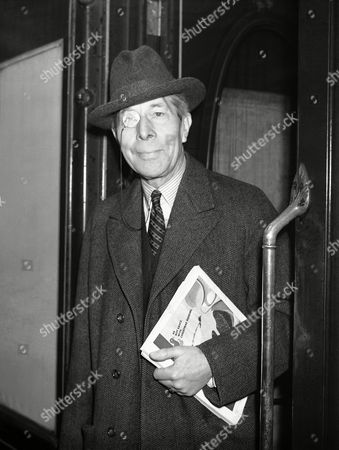 Stock Picture of British film star George Arliss, at Waterloo Station, London before departing for New York on