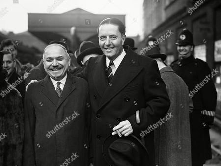 Robert Hudson, the Secretary for the Department of Overseas Trade in the British government, left London on his trade mission to northern Europe, during which he will visit Warsaw, Moscow, Helsinki and Stockholm. Robert Hudson, right with his arm round the shoulder of Ivan Maisky, the Russian Ambassador in London, smiles broadly before leaving Victoria Station, London, on