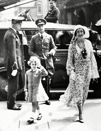 George, Duke of York, Elizabeth, Duchess of York, Princess Elizabeth George Dukeof York and Elizabeth Duchess of York, accompanied by little Princess Elizabeth who is saluting, are shown arriving on at Olympia in London to attend the Royal Tournament