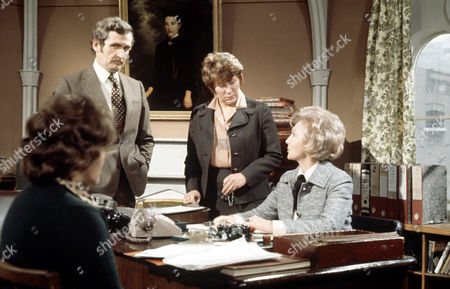 Googie Withers (seated) with Jerome Willis and Mona Bruce in 'Within These Walls'