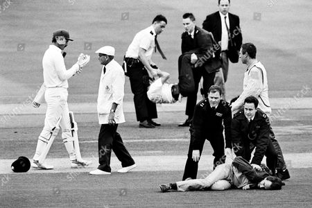 MCC v Transvaal cricket match, Lords - Anti-Apartheid protesters are restrained by police after seven men stormed the square in an attempt at disruption, after the first ball was bowled by the West Indian Joel Garner. This was the first visit to Lords by a senior South African side for 27 years. The umpire is Dickie Bird.
