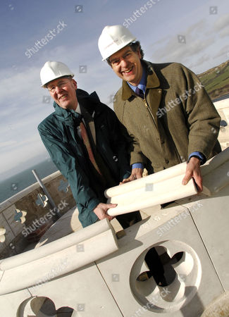 Stock Picture of Adrian Tinniswood (Heritage Lottery Fund) and Peter Pearce (right, Landmark Trust) put the final brick in place on the Clavell Tower