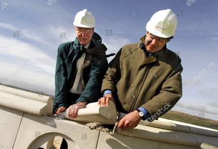 Stock Photo of Adrian Tinniswood (Heritage Lottery Fund) and Peter Pearce (right, Landmark Trust) put the final brick in place on the Clavell Tower