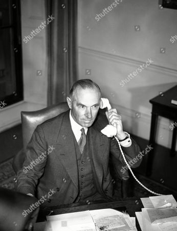 Stock Image of Admiral of the Fleet Lord Ernle Chatfield, who has just been appointed Britain's Minister for Co-ordination of Defence in succession to Sir Thomas Inskip, at work at his desk in Whitehall, London, on
