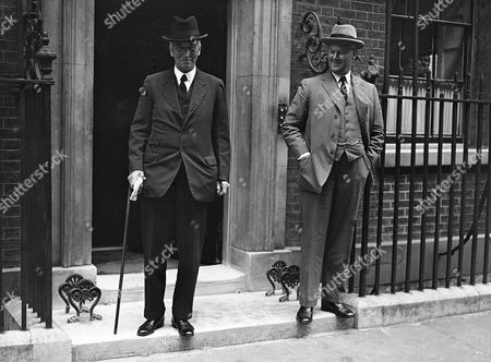 Britain's Home Secretary Sir John Simon, left, and Sir Thomas Inskip arrive at No. 10 Downing Street, London,, for a meeting of the Foreign Affairs Committee of the British Cabinet to discuss the civil war in Spain