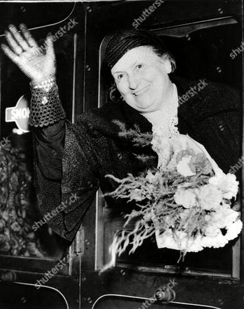 Montessori Dr. Maria Montessori, education expert and founder of the Montessori schools, waves from the train window as she arrives from Barcelona in London, England, on