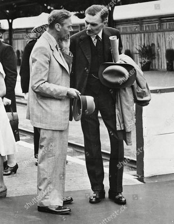Britain's King George VI, left, talks with his private secretary Sir Alan Lascelles, somewhere in South Africa, April 1947