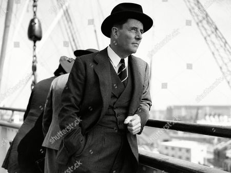 Robert Hudson, Secretary of the Department of Overseas Trade, left England for America on the Queen Mary. He is to visit the New York World's Fair and have important conversations with Cordell Hull in Washington and with Harry Hopkins, the U.S. Secretary for Commerce. Robert Hudson snapped on board the Queen Mary at Southampton, before leaving on