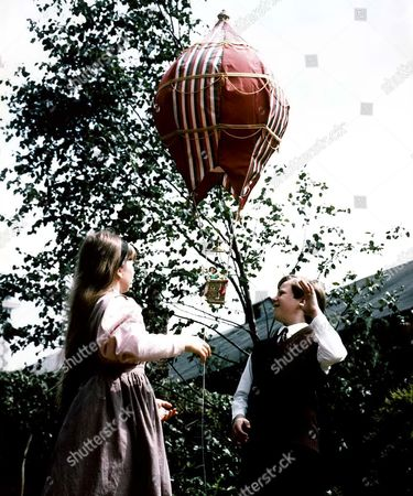 Stock Image of 'Return of the Antelope' TV - 1986 - Gerald [Alan Bowyer] and Philippa [Claudia Gambold] launch their toy hot-air balloon with Brelca [Gail Harrison] on board.