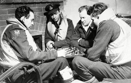 Members of the Royal Air Force American Eagle Squadron relax with a game of checkers at their base, . From left to right are Pilot officer Ben F.Mays, Wharton, Texas; J.M. Kelly, Oakland, Calif.; Pilot officer H.H. Strickland, Detroit, Mich.; Pilot officer Tom Andrews Costa Mesa, Calif